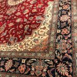 black and red rug with floral pattern