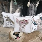 pillows on the ground with animals wearing funny stuff